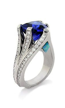TANZANITE AND PYRAMID OPAL RING Trillion shaped Tanzanite set in 18k white gold with a pyramid opal inlay and 1.60ctw white diamonds.