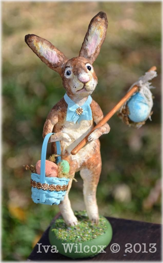 https://flic.kr/p/dTHehU   Spun Cotton Easter Bunny Rabbit Victorian Folk art   By Iva Wilcox ( copyright 2013) - It's as if he has hopped from a Victorian Easter postcard! This sweet spun cotton Easter bunny is getting ready to deliver Easter eggs. He will be available on eBay, starting tonight 2/10/13. See my profile for a link or search for my ebay ID ivas_creations. Happy Easter!