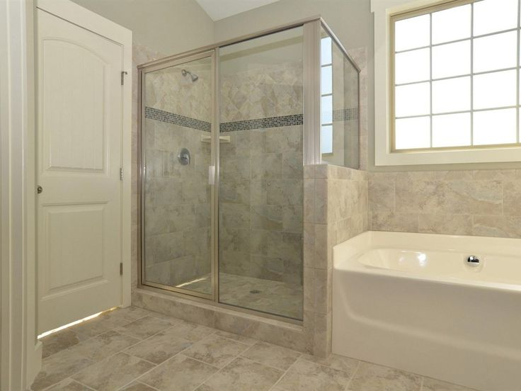 master bathroom with tile shower with glass deco and tile floor
