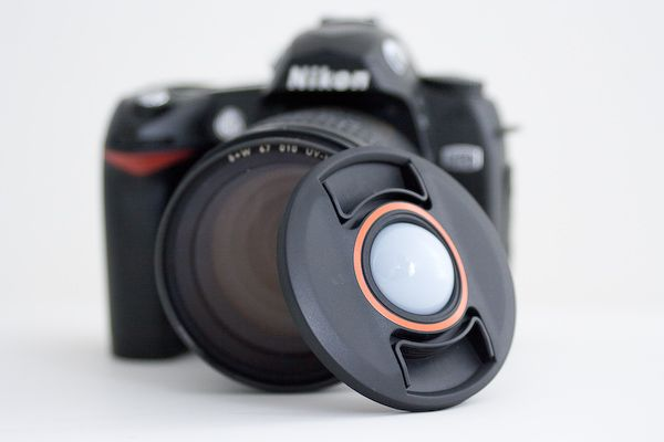 "White balance lens cap ""perfect white balance every time, No gray card required"""