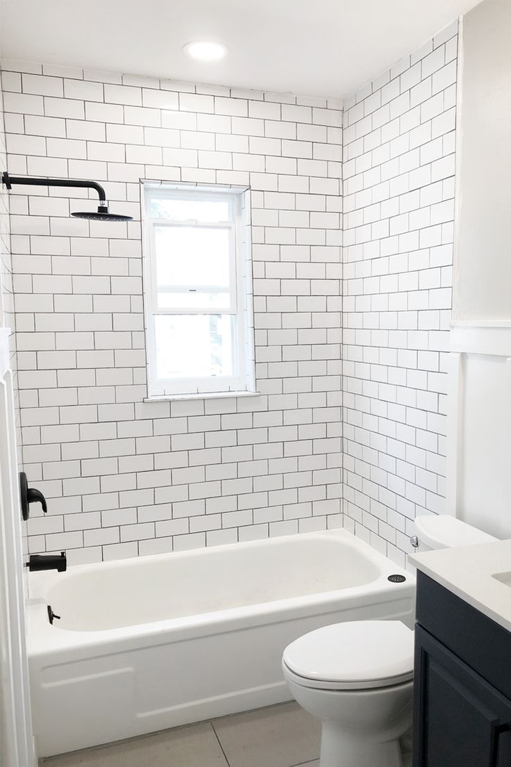 This Outdated Bathroom Gets A Total Overhaul With Fresh White Subway Tile Board And Batten Small Bathroom Renovations Restroom Remodel Small Bathroom Remodel