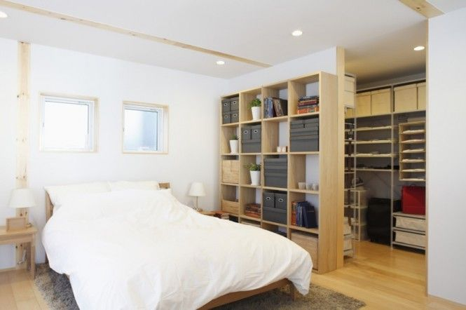 The open plan layout continues even into the bedroom, with an open sided walk-in wardrobe.