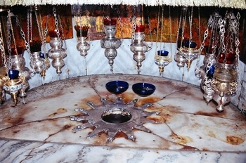 The birthplace of Christ, which is kissed by many pilgrims. Photo lolay. (http://www.sacred-destinations.com/israel/bethlehem-church-of-the-nativity)