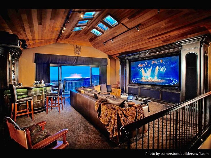 Floor to ceiling windows open up this cozy man cave ...