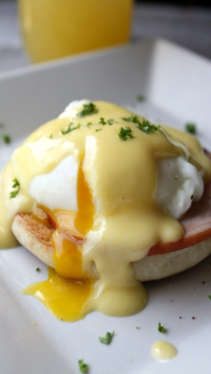 Eggs Benedict. A poached egg on top of crispy Canadian bacon on a warm buttery toasted English muffin with a creamy Hollandaise sauce is the ...