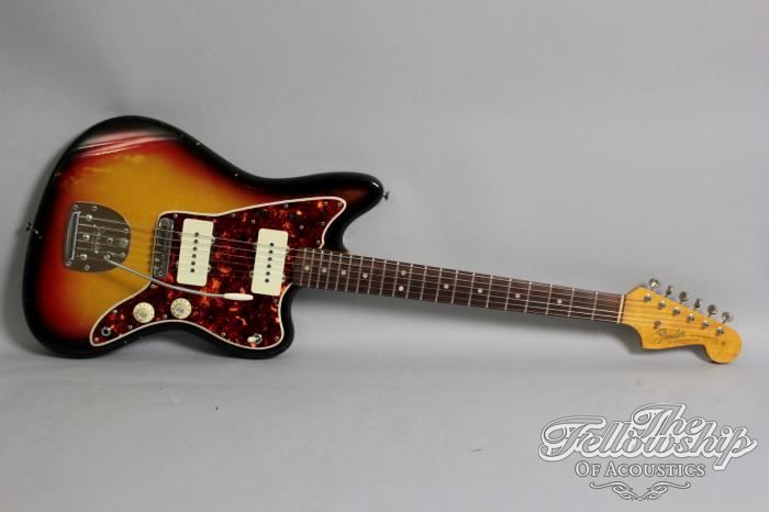 "1965 Fender® Jazzmaster® ($8.350) L series, 3-tone sunburst, Jazzmaster® in excellent conditionn. Alder body, maple neck with rosewood fingerboard, dot markers, 21 frets, all original pickups and electronics, hardware and plastics, tremolo, tuners up to the screws. Killer Indo rock sound! 41.7 mm (1 21/32"") width at the nut, 650mm (25 1/2"") scale. Guitar with the original -no logo- Fender® hardcase."