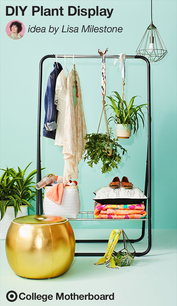 "Help your college student personalize their living space with this chic yet functional take on a clothing rack by Mom pinner, Lisa Milestone: ""Create an inspired dressing area in your student's dorm space. Mix in low maintenance plants or faux ferns to add in some greenery."" This pin was made by Moms, for Moms to make sending any student off to college easy, thanks to the On to College Motherboard."
