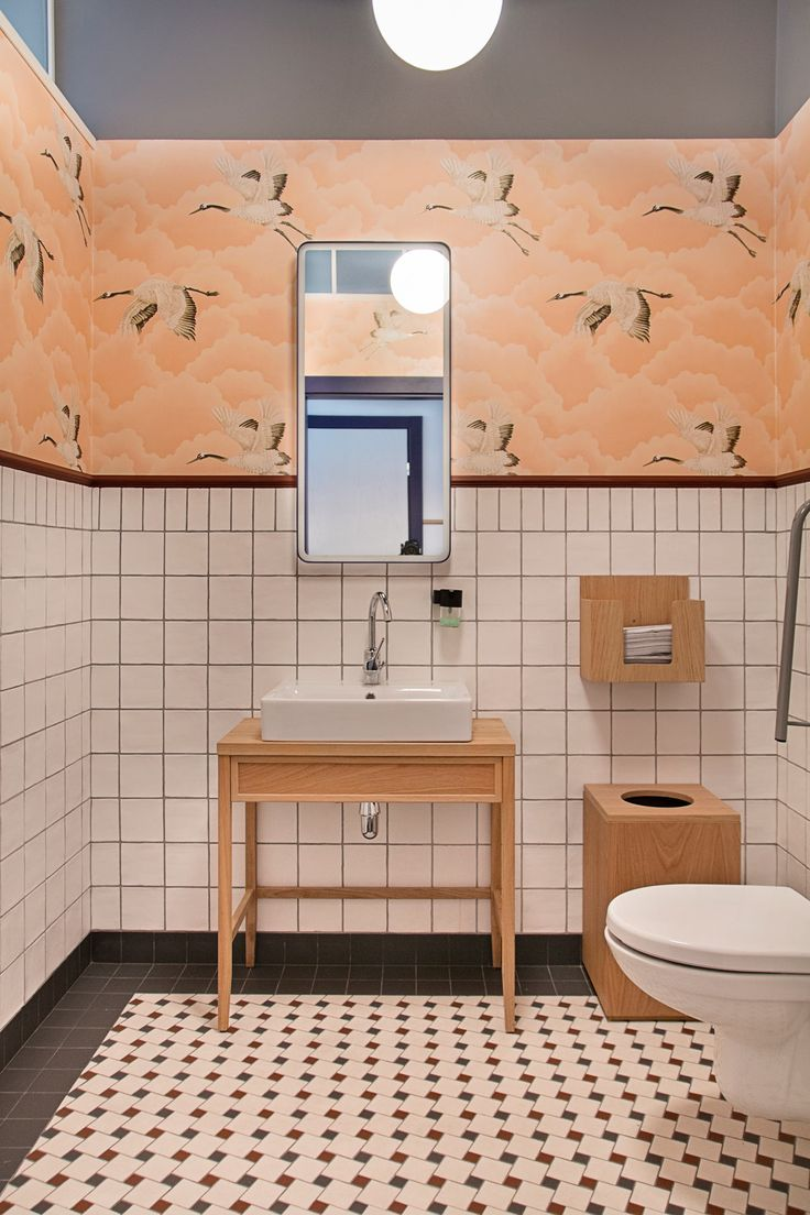 Colorful bathroom with stork wallpaper and colorful tile