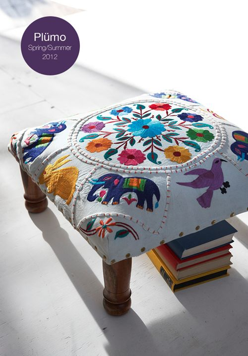 Cover an old stool/foot rest with an old blanket or tablecloth for the same effect