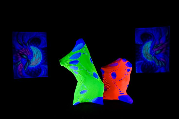 Dancers in cocoons and airbrush paintings in UV light - black light show Anta Agni http://antaagni.com/uv-light-show/