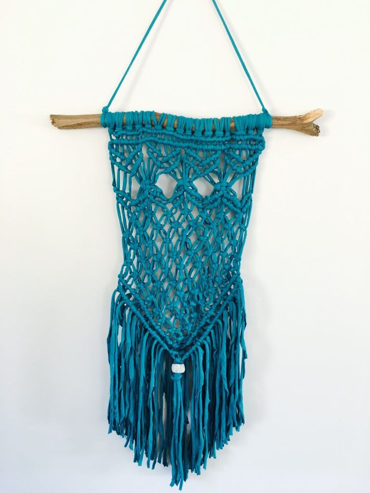 Teal green handmade macrame wall hanging/decor made with trap-art t-shirt/tshirt yarn and hung on eucalyptus branch by waffleandweave on Etsy