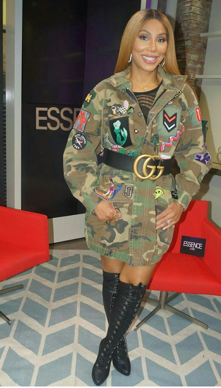 Tamar Braxton army green jacket. Over the knee Christian Louboutin boots.