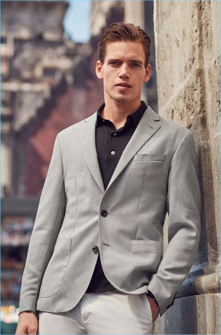 A smart vision, Mark Cox dons a grey sport coat, blazer, and pants from Black Brown 1826.