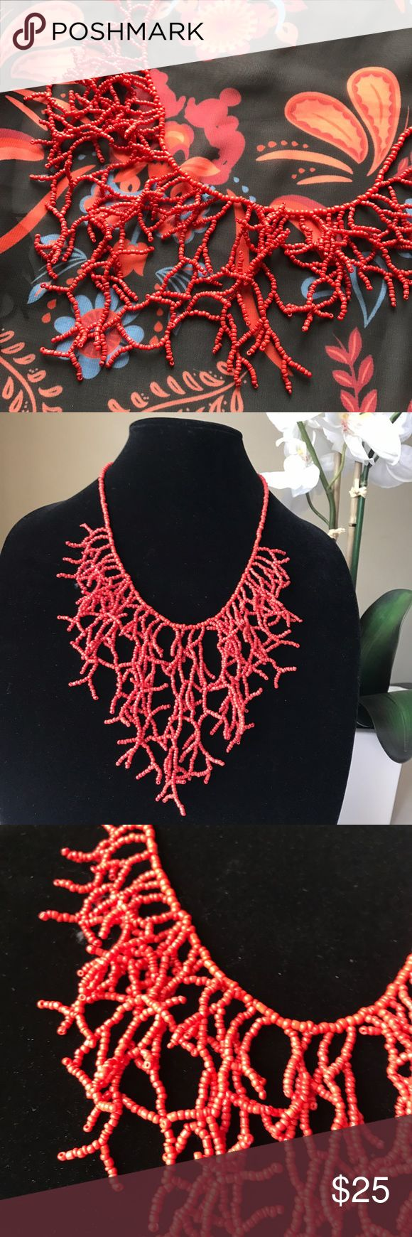 "Beaded ""Coral"" Statement Necklace Vacation in style with this unique bib-style statement necklace. Inspired by coral, this piece is done in hand sewn beadwork. Measures approximately 18"" long with a 2"" extension. Drop is approximately 4 1/2"" at longest point. Jewelry Necklaces"