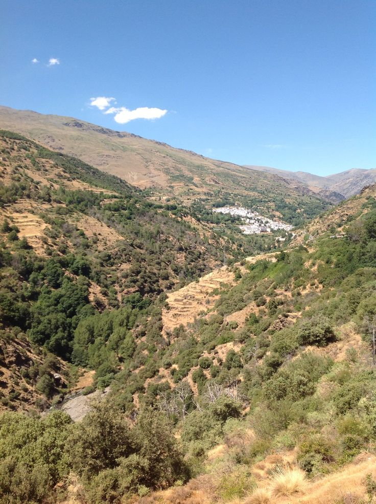 Driving around in the Alpujarras with the town of Trevélez in the background (Andalucia, Spain). B&B Cortijo Valavero.