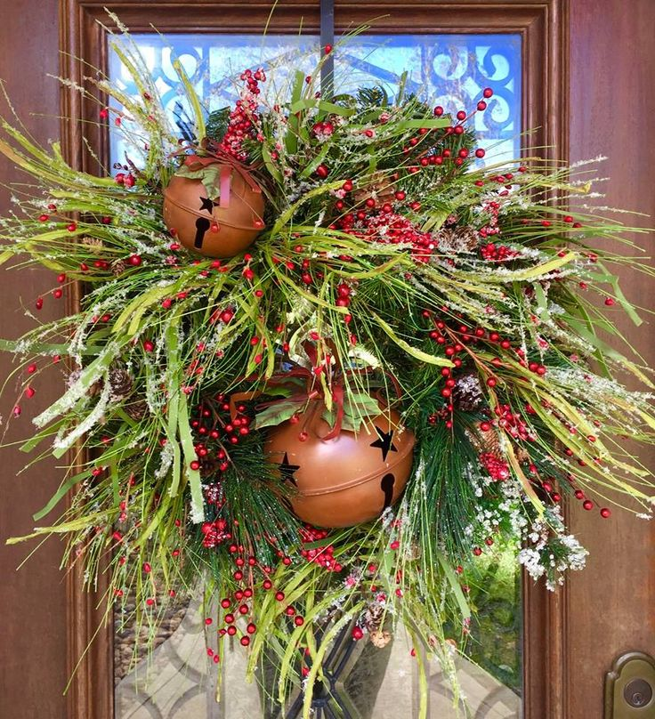 Winter greenery wreath with rustic bells can also be used for Christmas