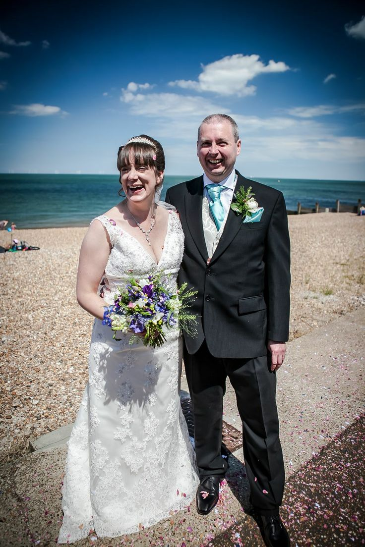 The bride and groom in front of the beach at Beacon House, Whitstable.