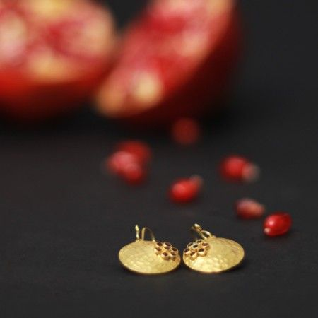 Textured Garnet Discs: A pair of gorgeous gold dusted textured discs dotted with garnet stones.