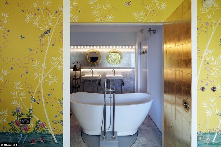 The ensuite to the bedroom doesn't have a conventional doorway entrance and contains a pivoting bath tub