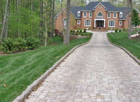 Here is a less expensive option to Belgian Block curbing. These are pavers bordering the paver driveway. Get more driveway ideas.