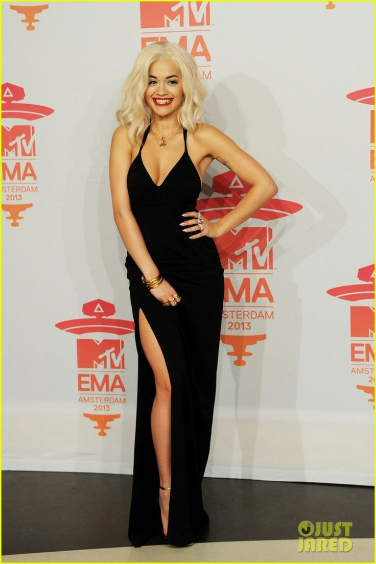 Rita Ora Simple is sexy! Platinum blonde curly bob.  Deep v shoulder strap dress. Thigh high slit. Simple gold ankles trap heels.  MTV Europe Music Awards in Amsterdam November 10 2013