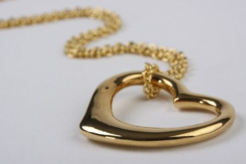 Open Heart Pendant Gold: A perfect gift for Valentine's day, this romantic pendant features contemporary and feminine design. Open Heart suspended on delicate belcher chain. 18 carat gold electroplated over brass. Chain length 23.5 inches / 60 cm. $117.90