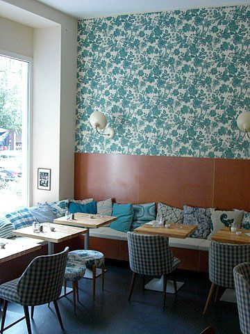 Cafe Fleury, Berlin. The cushions and wall paper give the idea of fun and homey.