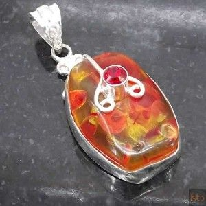 Amber, Red Zirconia Pendant plated 925 Sterling Silver 11 Gms 2 Inches#Metal: plated with genuine 925 Sterling Silver#Gemstone: #Gemstone: Amber, Red Zirconia#Pendant Length: 2 Inches#Pendant Weight: 11 Gms#OUR ALL JEWELRY IS EXCLUSIVE AND OWN DESIGNED# ₹567