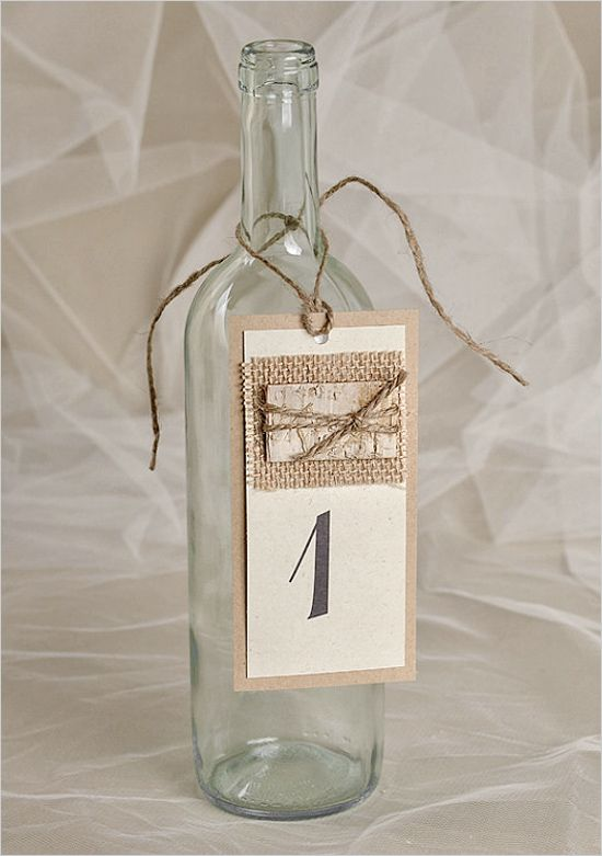 Wine bottle table numbers. Wedding Details: For Love Polka Dots ---> http://www.weddingchicks.com/2014/05/27/rustic-wedding-must-haves/