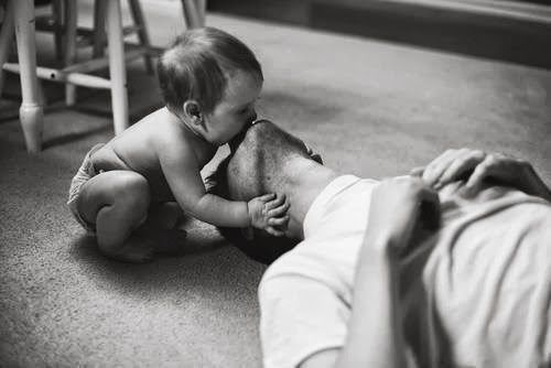 Dads and theirs... their little ones. Not much can surpass this... love, simplicity, genuine /.,