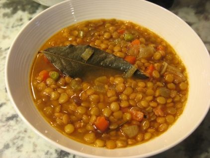 Ingredients:  ½ cup (125 ml) olive oil  2 ½ cups lentils moderate size  6.5 cups water  1 medium onion, chopped  2 cloves garlic, chopped  1 large carrot sliced  2 bay leaves  1 tablespoon balsamic type vinegar or red wine vinegar strong taste  salt and pepper