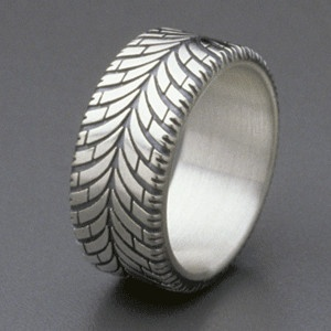 Tire wedding band. Lol perfect for Sloan
