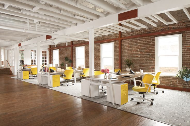 Exposed beams and brick, neutral floor covering, ONE accent color (yellow)