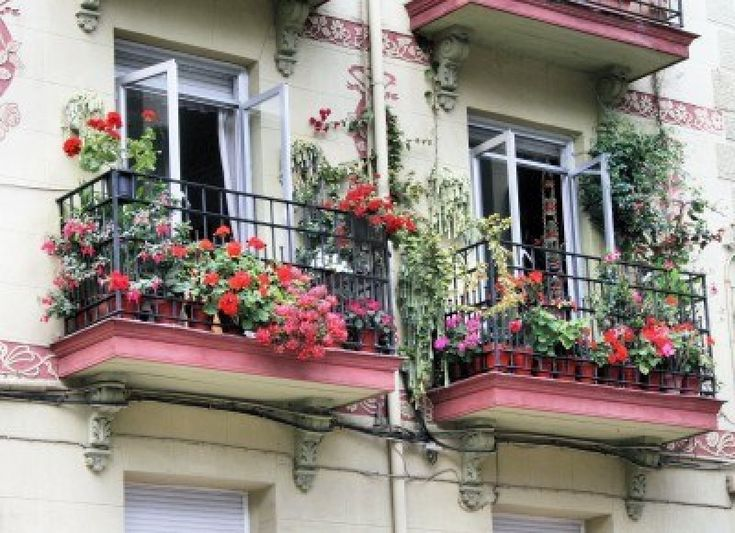 Two old balconies with flowers in Santander /Spain/ Stock Photo