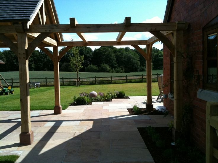 The new, bespoke oak pergola & gazebo, designed by Elizabeth Buckley. The pergola visually links the gazebo with the house & provides a lovely 'frame' to the view beyond.