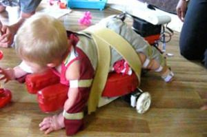 As part of a study, a baby tries out an earlier iteration of the SIPPC.