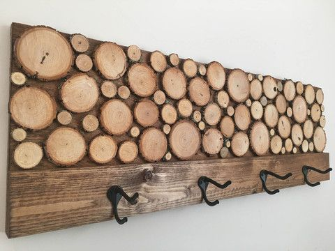 """Wood Slice Art Coat Rack - Make a statement with this stunning piece of art that has a dual function.  Quit hanging your coat on the treadmill and put it in place with this hand made coat rack.  Each rack is hand made using reclaimed wood and will have some slight variations in appearance, but size will always be the same.  Measures 36"""" x 12"""" (1 3/4"""" deep not including hooks).  $74.99"""