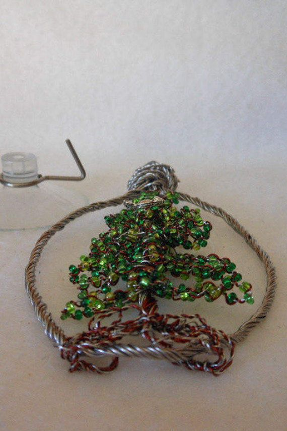 $$$ FREE SHIPPING**FREE SHIPPING**FREE SHIPPING$$$ Wire Tree Ornament 19/17 Pine Tree with sitting Bird Hand twisted wire tree ornament. Characteristics of a Pine Tree. Newly created with no tags. 2017 Using recycled stainless steel lock wire. Please take the time to read more on this