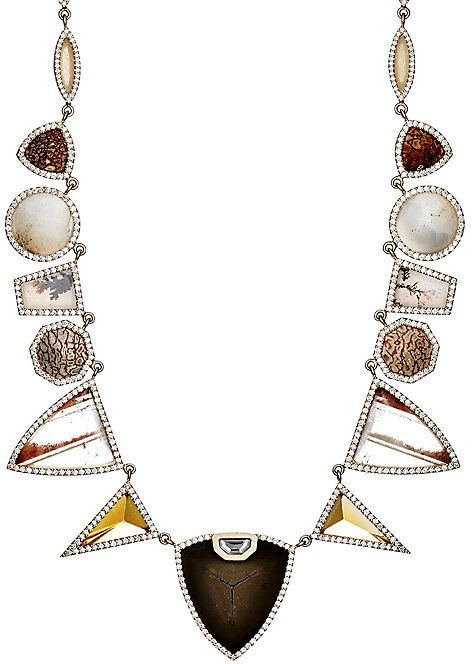 Exclusively Ours! Embellished with shimmering pavé white diamond frames, Monique Péan's one-of-a-kind geometric-link necklace is crafted in the U.S. of satin-finished 18k white gold set with fossilized dinosaur bone, camel bone, and various colorful gemstones. Symmetric gemstone design on either side of central black septarian link. Black septarian accented with a single octagonal white diamond. Chain consists of marquise-shaped links. 6.04 ct conflict- and