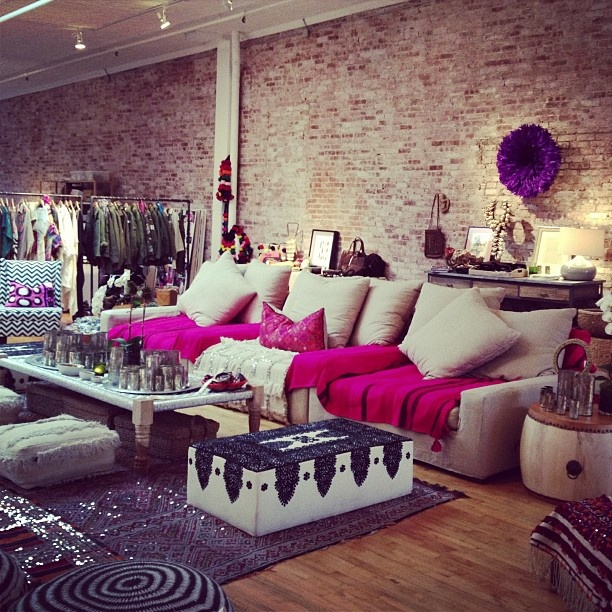 .@Hanna Claire Bejarasco   It's Figue's showroom, but would make a pretty spectacular living room space. (global exposed brick, sparkle, comfortable)