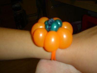 pumpkin bracelet balloon twisting - Halloween Balloon Animals