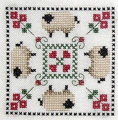 Cross-stitch Sheep biscornu ... no color chart available, just use the pattern chart as your color guide.. or choose your own colors...