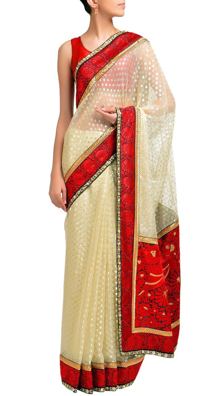 Sabyasachi Ivory woven silver buti and red bird pallu sari.