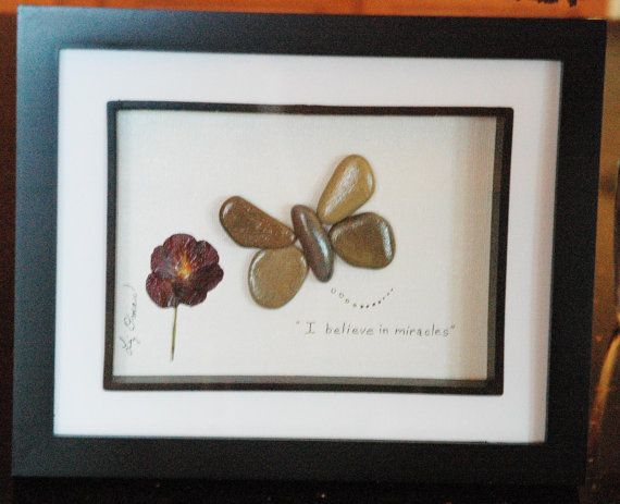 Butterfly with pansy...pebble art by BeginAgainCreative on Etsy