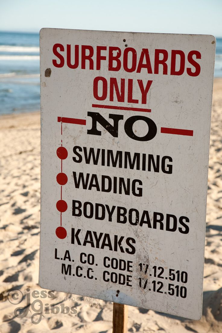 As the sign says, at the world famous surf beach, it's surfboards only, Malibu, Los Angeles, California