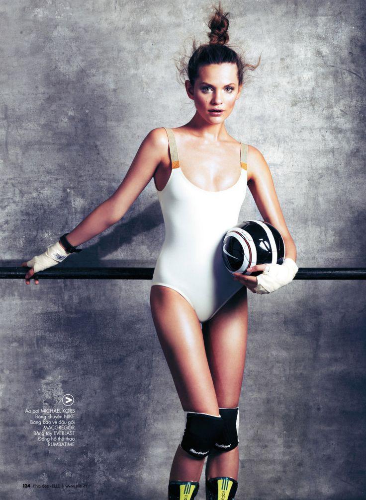 Regina Feoktistova Wears Olympic Worthy Fashion for Elle Vietnam July 2012