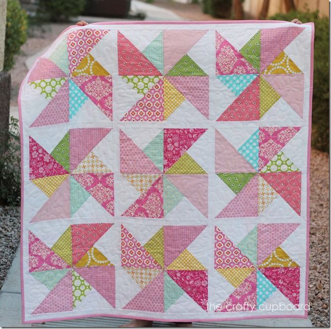 "Pink Pinwheels by the Crafty Cupboard   Quilt measures 40.5"" x 40.5"" and uses various prints for the pinwheels."