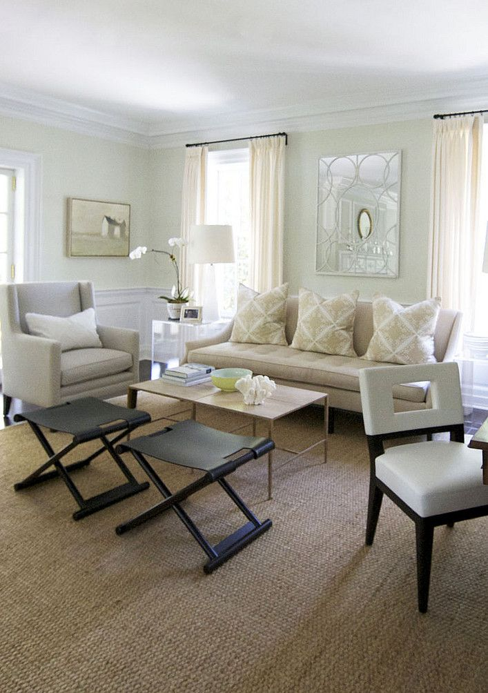 Neutral cream living room with seagrass rug. | I don't like the two black tables but I love everything else!