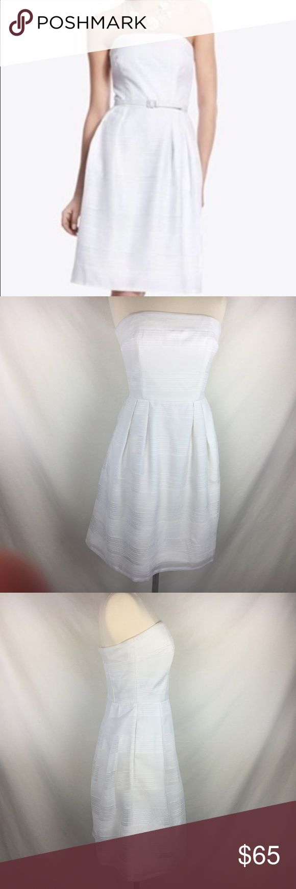 WHBM White Stripe Party Dress sz2 NWOT This dress is BNWOT, never worn. Though the sample pic shows it with a belt it never was sold with one as the description from their website states. It's darling without a belt. Or you can use any belt of any color you'd like.   Size 2. It zips all the way up but my mannequin is just a bit too big. White House Black Market Dresses Strapless