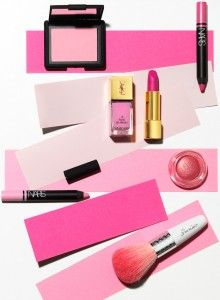 Beauty product magazine editorial. Pink make up products on pink strips of…